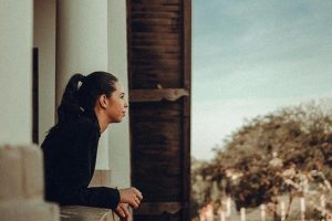 Lady looking over balcony - Your Partner Reflects You